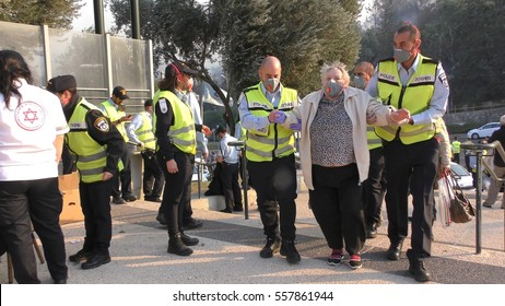 HAIFA, ISRAEL, NOVEMBER 24th, 2016: Elderly people evacuated by police and taken to public shelters in Haifa, Romema, Israel.