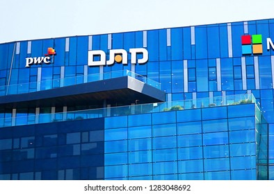 HAIFA, ISRAEL - SEPTEMBER 18, 2017: View of office building with famous logos (PWC)  in Haifa MATAM high tech campus. The Park is an international technology center