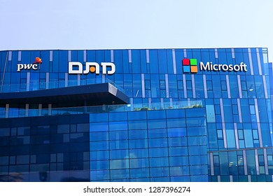 HAIFA, ISRAEL - SEPTEMBER 18, 2017: View of office building with famous logos (PWC and Microsoft)  in Haifa MATAM high tech campus. Microsoft company is best known for it's software products