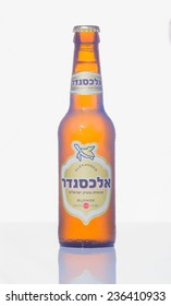 HAIFA, ISRAEL - SEPTEMBER 27, 2014: A bottle of alexander blonde beer, winner of the European beer star competition in 2014 (English-Style Golden Ale category) on a white background in Haifa, Israel