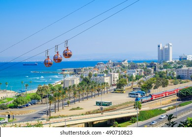 HAIFA, ISRAEL - SEPTEMBER 29, 2016: View of the bay, downtown and the cable car, with locals and visitors, in Haifa, Israel