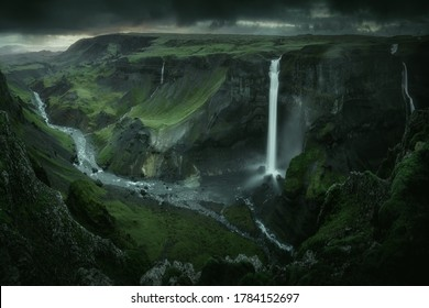 Haifoss waterfall in South Iceland in the dusk. Beautiful nature dramatic moody landscape. Panorama view. Color filter toned - Shutterstock ID 1784152697