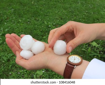 Hail after storm in hand