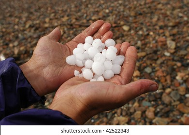 hail after storm on hand