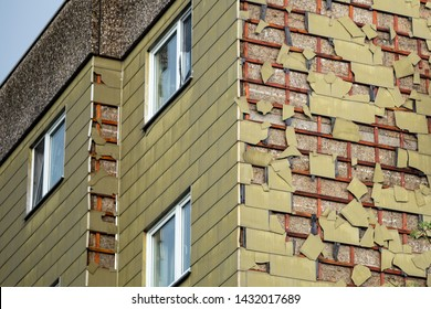 Hail damage to asbestic cladding of an older house