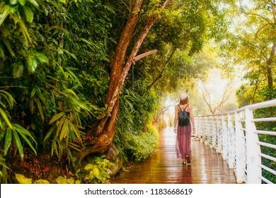 Hainan, Sanya, Phoenix park. Girl in tropical forest.