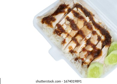 hainanese chicken rice or stemed chicken rice with sauce and cucumber in a foam box isolated on white background ,close up shot , asian food style