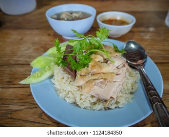 Hainanese chicken rice , Thai gourmet steamed chicken with rice, bean sauce and soup.