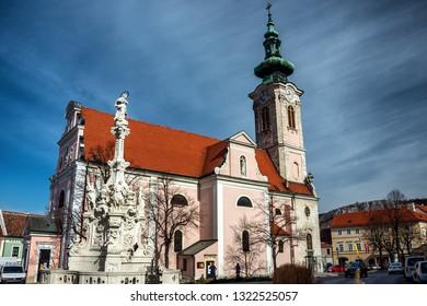 HAINBURG/ AUSTRIA FEB 23, 2019: The church on the main square of medieval town Hainburg an der Donau, town is in the Bruck an der Leitha district, Lower Austria, Austria. The easternmost Austrian city