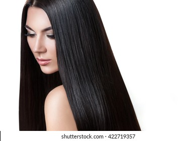Hair. Beautiful brunette girl . Healthy long hair . Isolated white background . Beauty model woman . Hairstyle