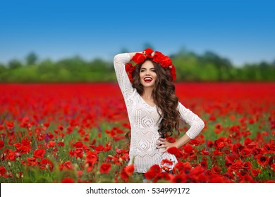 Hair. Beautiful happy smiling teen girl portrait with red flowers on head enjoying in poppies field nature background. Carefree woman. Wellness well-being happiness concept.