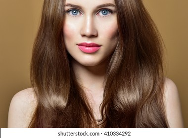 Hair. Beauty Fashion Model Woman with Long and Healthy Brown Hair. Beauty Brunette Girl.