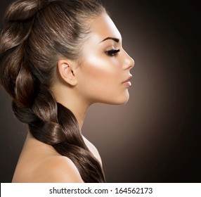 Hair Braid. Beautiful Woman with Healthy Long Hair. Hairdressing. Hairstyle. Beauty Glamour Fashion Model Girl Portrait. Perfect Skin and Makeup
