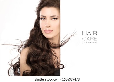 Hair care and beauty concept with a beautiful model girl wearing subtle makeup with gorgeous healthy long hair. Beauty portrait isolated on white in a close up cropped view