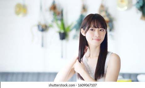 Hair care concept of young asian girl.