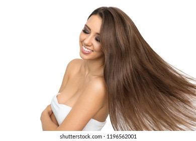Hair care concept.Woman portrait. Hair care. Beautiful young brown-haired woman is smiling, isolated on white