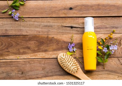 hair care serum for damaged hairs with comb health care beauty head and hairs of lifestyle woman arrangement flat lay style on background wooden