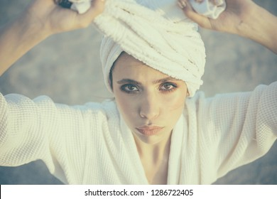 Hair care. Skincare model after spa bath. Skincare at spa. Beauty salon. Beauty routine and hygiene care. Bathing habits. Young woman in bathing gown. Spa cure. Pretty woman wear bath towel on head.