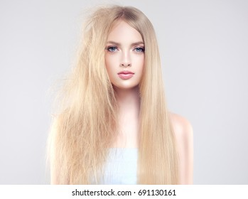 Hair care . Straightening ,smoothing and treatment of the hair .  Girl with straight and smooth hair on one side of the head . The second side of the head tangled and unbrushed hair .