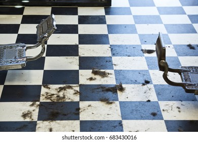 Hair clippings on the checkered floor of an old barbershop in San Diego, CA.