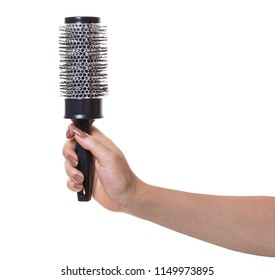 hair comb in female hand on white isolated background