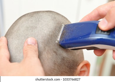 Hair cutting in a child without a nozzle, almost on bald. Getting rid of lice