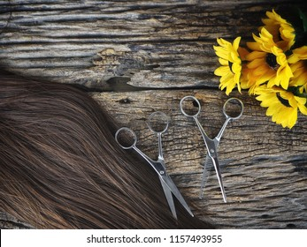 Hair cutting shears and hair with flowers