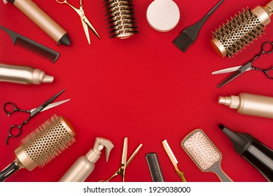 Hair cutting tools arranged in a circle on red background