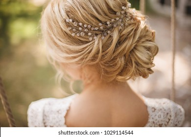 Hair do with an elegant bridal hair accessorie