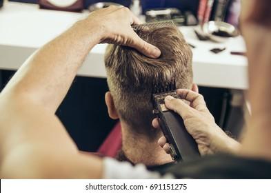 Hair dresser point of view, holding hair clipper