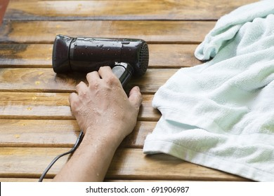 Hair dryer electric shock and wet hand
