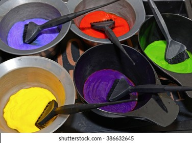 Hair dye in bowls and brush for hair coloring