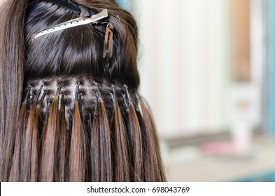 Hair extension, girl and her head turned back