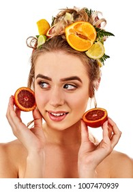 Hair and facial mask from fresh fruits for woman concept. Girl holds halves of grapefruit for homemade organic skin therapy on isolated. Woman in testing new treatment. Fruit therapy .