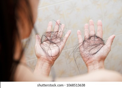 Hair falling out in two hands after rinse off shampoo.