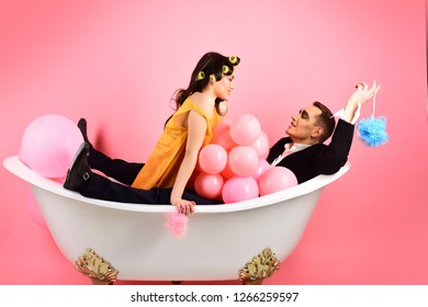 Hair grooming routine. Couple in love in bath tub. Couple of mime man and sexy woman enjoy bathing. Bubble bath day. Beauty routine and personal hygiene. Bathing hygiene habits. Regular grooming.