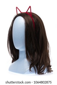 Hair hoop in shape of cat ears on mannequin head isolated on white background