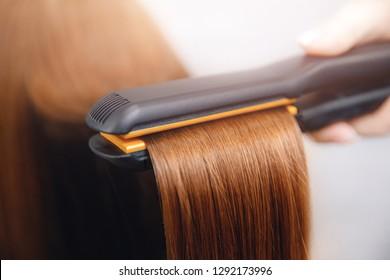Hair iron straightening beauty care salon spa.