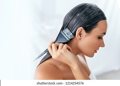 Hair Mask. Woman Applying Conditioner On Long Hair With Brush, Hair Care Treatment
