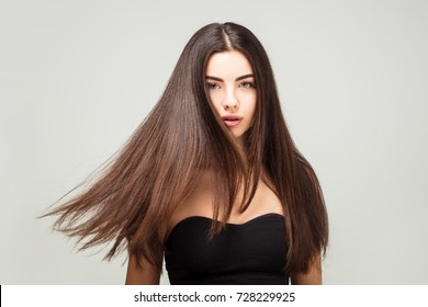 Hair model, Hairdresser salon. Beauty Fashion Model Woman  Healthy Brown Hair looking at camera.