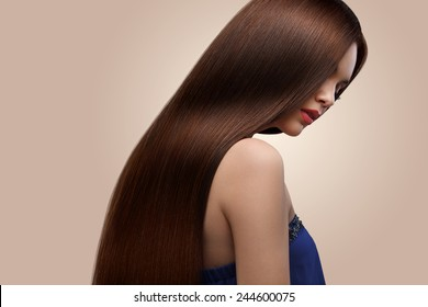Hair. Portrait of Beautiful Woman with Long Brown Hair. High quality image.