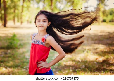 Hair of pretty little girl hair is blowing in the wind
