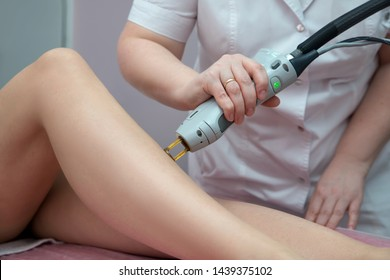 Hair removal cosmetology procedure by  therapist at cosmetic beauty spa clinic. Laser epilation and cosmetology. Hair remover technology.