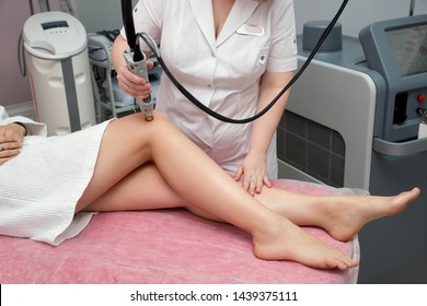 Hair removal cosmetology procedure by  therapist at cosmetic beauty spa clinic. Laser epilation and cosmetology. IPL, SHR, LHE hair remover technology.
