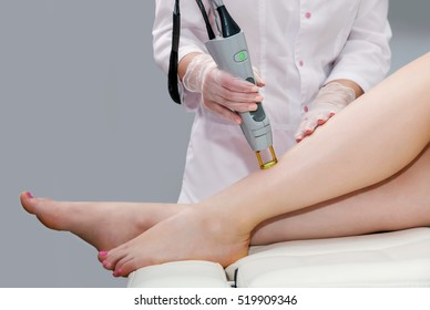 Hair removal cosmetology procedure from a therapist at cosmetic beauty spa clinic. Laser epilation. Cosmetology and SPA concept.