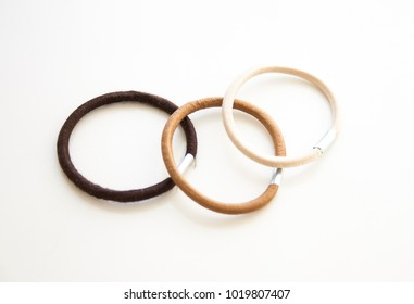 Hair rubbers on white background.