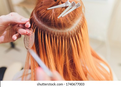 Hair salon, beauty spa. Procedure of hair extensions.