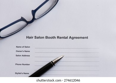 hair salon booth rental agreement  on the white paper with pen