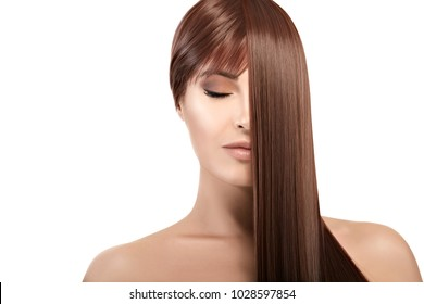 Hair salon concept. Beautiful model girl with gorgeous long brown healthy hair. Keratin Straightening Treatment. Care and hair products.