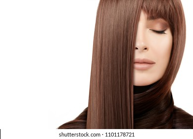 Hair salon concept. Beautiful model girl with shiny and healthy straight hair. Keratin straightening treatment. Care and hair products. Close up beauty portrait isolated on white with copy space